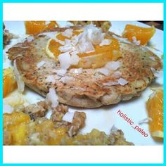 Lovely breakfast pancake.  Orange,  cinnamon, walnut and chia seed pancake.  Paleo, gluten, dairy and sugar free.  I made an orange and walnut puree to go on the side and squeezed fresh orange juice over the pancake.  I also put orange juice and zest in t