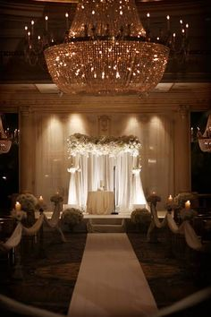 Indoor Hotel Wedding Ceremony. So gorgeous!! I would prefer more candles. #hotelwedding #ceremony #chandelier