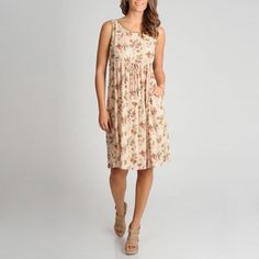 @Overstock.com - La Cera Womens Tiered Printed Casual Dress - This feminine dress by La Cera features a gentle floral pattern and flattering tiered waist. With a scoop neck and convenient front pockets, this casual dress is fashionable and functional.   http://www.overstock.com/Clothing-Shoes/La-Cera-Womens-Tiered-Printed-Casual-Dress/7951801/product.html?CID=214117 $49.99