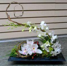 Beautiful Orchid Arrangement Design https://www.onechitecture.com/2018/01/19/beautiful-orchid-arrangement-design/