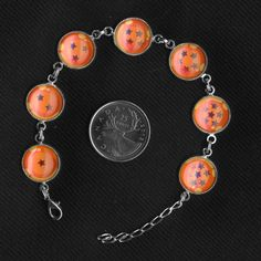 Dragon Ball Z dragon balls glass and metal bracelet on Etsy for $25.