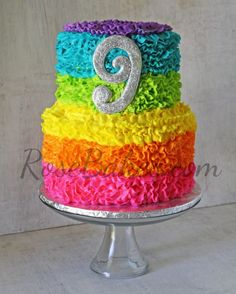 Electric Rainbow Buttercream Ruffles Cake | http://rosebakes.com/electric-rainbow-buttercream-ruffles-cake/