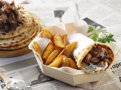 Pork gyro with tzatziki sauce by Greek chef Akis Petretzikis! A delicious, traditional, homemade pork gyro with tzatziki sauce, bagels and sweet potato chips!!
