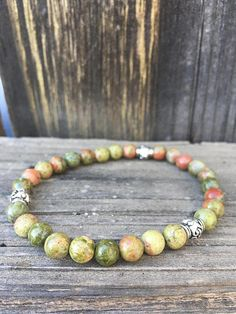 Unakite: gentle powerful energy, balance of emotion, past life healing, gain confidence, helps heal seperation issues, calm and gentle energy,
