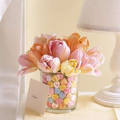 This is a cool centerpiece idea but fill the vase with m&ms instead of the hearts... for a m&m themed wedding