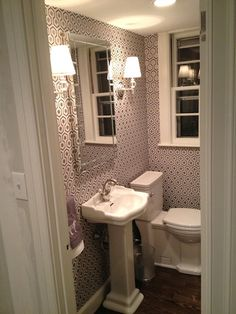 Toilet is Porcher Lutezia round front,  Barclay's 18″ Stanford pedestal.    faucet from Jado (via Waterspot)   mirror scored from West Elm   sconces from Lamps Plus