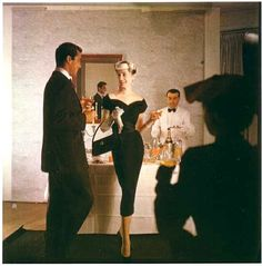 Slim black cocktail dress by Jacques Fath, 1954