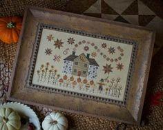 Plum Street Samplers Cinnamon Stars - Cross Stitch Pattern. Stitch Count: 168W x 100H. Model stitched on 35 ct chamomile tea using Gentle Arts & Weeks Dye Works