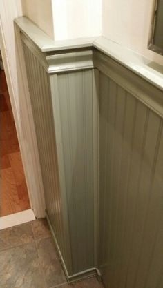 """Capping over 3/4"""" tile lip. Not a single nail was used in the wainscoting & trim installation. All bonding of materials was done using Loctite """"Power Grab""""; once cured, it's stronger than nailing. Worked perfectly bonding wainscoting panels onto tile wall."""