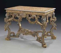 """From Yvonne Rose, """"Antique Furniture"""" board  A GERMAN GILTWOOD AND SILVER-PAINTED SIDE TABLE  CIRCA 1700"""
