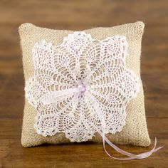 burlap and doily ring pillow: Square burlap and doily ring pillow with a light pink bow and center pearl.