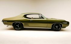 '68 GTO. Mine will be GM Cyber Metallic Gray, less chrome, shaved door handles, similar rims.