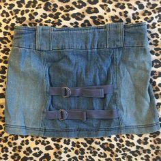 Betsey Johnson denim mini skirt Cool super stretchy denim mini. Has straps across the back. No visible flaws. Betsey Johnson Skirts Mini
