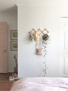 Soft and pink bedroom decor with a vintage accordion hook.