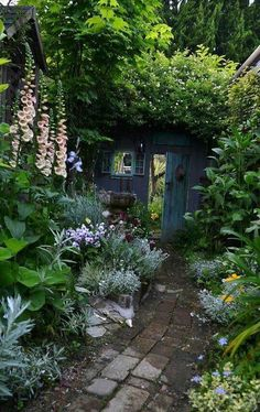 Garden inspiration / enchanting green space with brick walkway, perennials and old garden gate