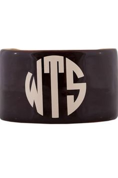 "This personalized, black, hand enameled cuff comes pre-formed however, can be adjusted to fit most adult size wrists. These monogrammed cuffs make a popular birthday gift, graduation gift, or bridesmaid gift! Turnaround time is 3 business days plus shipping time. For customization, please email Stylist@shoptiques.com with you choice of vinyl color, monogram style and monogram initials. All custom items are final sale.     Measures: 1.5"" W   Personalized Black Cuff by Party Cat. Accessories…"