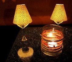 Decorating with wine glass lamps...such a simple idea- using block printed paper to make little lamp shades for wine glasses.