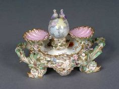 This unusual Coalbrookdale desk set, dating from c1825-1830, is decorated with china flowers and two china doves. The figures used to decorate Coalbrookdale ware, which also included cherubs, were probably the earliest figurines made at Coalport