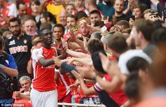 Applause: The Arsenal youngster laps up the admiration from the home fans...