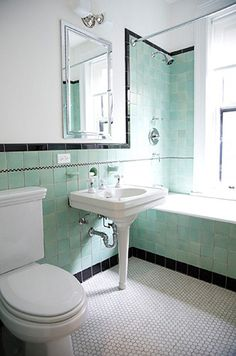 A perfectly done new vintage bathroom.  I especially love the medicine cabinet.