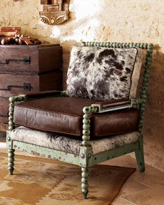 hair-on-hide and leather chair with a mint wood frame