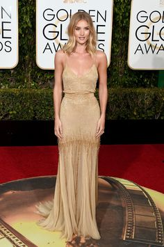 Rosie Huntington-Whiteley looked like a gold goddess at the Golden Globes.