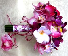 ♥ Real touch Orchids in mauve pink, magenta and fuchsia, Plumerias in iced Lavender, accented with crystals. Bouquet dressed in white satin and finished with dusty rose and sandalwood rose french knots. Obsessed but I want it in purple