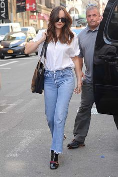 Fifty Shades of Grey actress, Dakota Johnson, was seen getting out of a car in Soho in New York a little while ago. I feel like each time we see her, her personal style is evolving and she's …