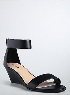 """<p>Sleek in black faux-leather, these mini wedges have a put-together edge, instantly updating (and completing) your outfit. A stretch ankle strap and a toe strap let you bare your sexy soles. Zip back.</p>  <ul> <li>2.5"""" wedge</li> <li>Man-made materials</li> <li>Imported</li> </ul>"""