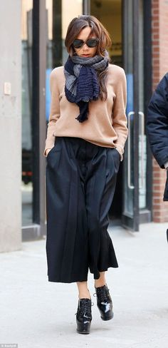 Every street's a catwalk: Victoria Beckham looked sensational in her casual ensemble as sh...