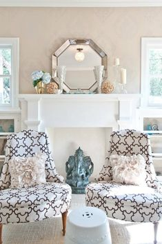 Contemporary living room with Pier 1 Octagon Mirror on fireplace mantel as well as mosaic glass vases.