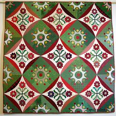 """""""Red and green"""" by Janet Treen.  It was made in 2006 and is a Piece O' Cake pattern from their book, 'Once Upon A Season'."""