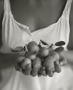 Kristoffer Albrecht, shallow depth of field, woman with fruit, close up. Lovely.