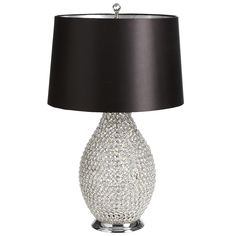 Beaded Crystal Lamp ~~ Countless crystal beads are individually strung to create this lamp's stunning vase, allowing you to see its outer form and inner beauty. The black satin shade, lined with reflective silver, is topped with a faceted crystal ball finial to focus its allure.