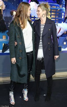 Happy ladies: Cara and Kate couldn't hide their smiles as they stood in front of the brand new festive decorations at the famous French store
