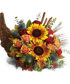 """Bountiful Cornucopia  What could be more festive than a """"horn of plenty"""" overflowing with autumn's cheeriest flowers. Doesn't it make you happy just to look at it? Order this radiant centerpiece for your holiday table."""