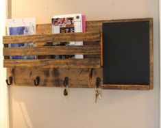 This mail organizer is perfect in rustic decor or country setting.  Item pictured is stained in Espresso and includes 3 key/robe hooks.  Color may vary depending on wood selection making yours unique.  All hand made from spruce wood.  Measures 18 long and 11.25 high.  Has two key hole slots cut on back for mounting to wall screws.