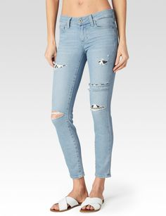 Our Legacy line features heritage-inspired denim woven to offer superior elasticity. The result is authentic, tried and true denim that lifts the butt and lengthens the legs with lasting shape from morning to moonlight. A super stretchy soft, mid rise, ultra skinny jean that grazes the ankle, making it perfect for showing off your favorite footwear. This beautiful light wash has destruction detailing, knee slits and is accented with vintage inspired Mayan patching. Has a vintage marble..