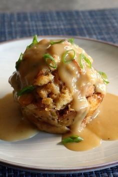 "Gravy-Stuffed Stuffing Muffins | ""Switch things up this Thanksgiving! Instead of serving a basket of dinner rolls, let your family feast on these gravy-stuffed stuffing muffins. Each muffin bakes up with a crispy exterior, a moist interior, and a nugget of thick, sausage-filled country gravy in the center."" #thanksgiving #thankgivingrecipes #thanksgivingsidedishes Home Recipes, Fall Recipes, Stuffing Muffins, Chicken Broth Can, Turkey Broth, Awesome Recipe, Thanksgiving Side Dishes, Fall Baking, Sausage Breakfast"