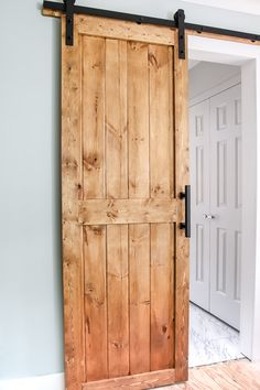 DIY barn door plans and tutorial. We snuck a little something on the back side of this door you have to see! Sharing our plans for our DIY barn door including a sneaky little trick we did to save floor space and add a lil' somn' somn' extra! Come see! Diy Barn Door Plans, Diy Sliding Barn Door, Making Barn Doors, Bifold Barn Doors, Building A Barn Door, Barn Plans, Farm Door, Wood Barn Door, Rustic Barn Doors