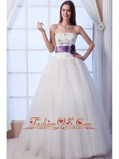 Luxurious A-line Strapless Floor-lengthTulle Beading and Hand Made Flowers Wedding Dress    http://www.facebook.com/quinceaneradress.fashionos.us  www.fashionos.com  You'll be glowing in this glamorous bridal gown dress. Baroque-style beadwork glimmers at the strapless neckline and form-fitting bodice for a richly embellished elegance. A dropped, Basque waistline with a flowered purple band lengthens the torso and slenderizes hips.