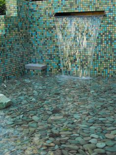 WOW, what a great use of glass tiles and river rock! This is an outdoor pond, but wouldn't it make a great outdoor shower? I...want...this.....
