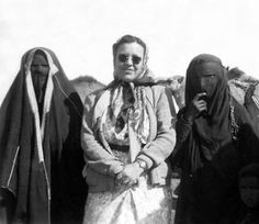 An American woman in Saudi Arabia,1951. A photo with two bedouin women in their traditional dresses