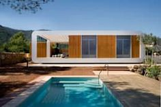 18 Dazzling Modern Swimming Pool Designs The Ultimate Backyard Refreshment Modern Prefab Homes, Prefabricated Houses, Modular Homes, Eco Homes, Cabinet D Architecture, Modern Architecture, Barcelona Architecture, Swimming Pool Designs, Swimming Pools