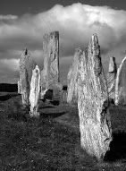 """Scotland's """"Stonehenge"""" at Callanish. Construction of the site took place between 2900 and 2600 BC, though there were possibly earlier buildings before 3000 BC. A tomb was later built into the site. Debris from the destruction of the tomb suggests the site was out of use between 2000 BC and 1700 BC.-wiki"""