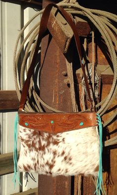 A personal favorite from my Etsy shop https://www.etsy.com/listing/231561231/western-cowhide-and-tooled-leather-purse
