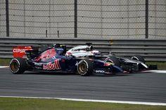 Daniil Kvyat (RUS) Scuderia Toro Rosso STR9 and Jenson Button (GBR) McLaren MP4-29 battle. Formula One World Championship, Rd4, Chinese Grand Prix, Race, Shanghai, China, Sunday, 20 April 2014