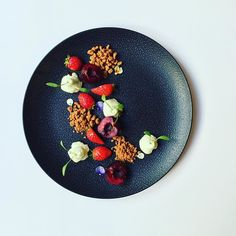 Marinated cherries in yuzu juice with strawberries, served with tarragon mousse and crunchy biscuits sable