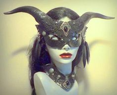 Womans size leather mask with cast horns,lace, silver tone metal accents, black agate stones, feather earrings,with matching collar...mask fits w/ black elastic cloth strap,collar has ties.