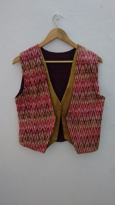 Check out this item in my Etsy shop https://www.etsy.com/listing/198784558/ikat-waistcoat